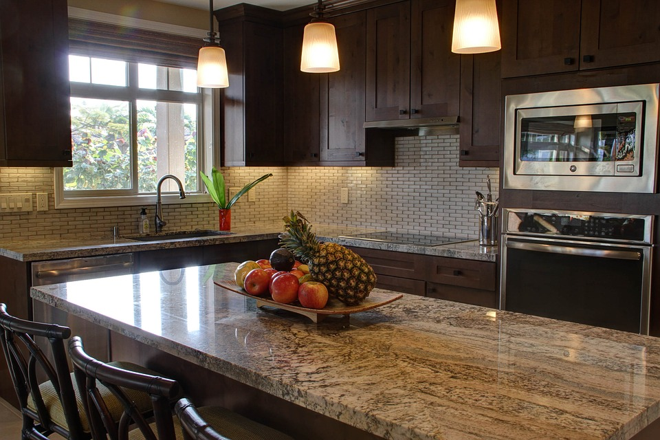 New kitchen fitted in dark wood