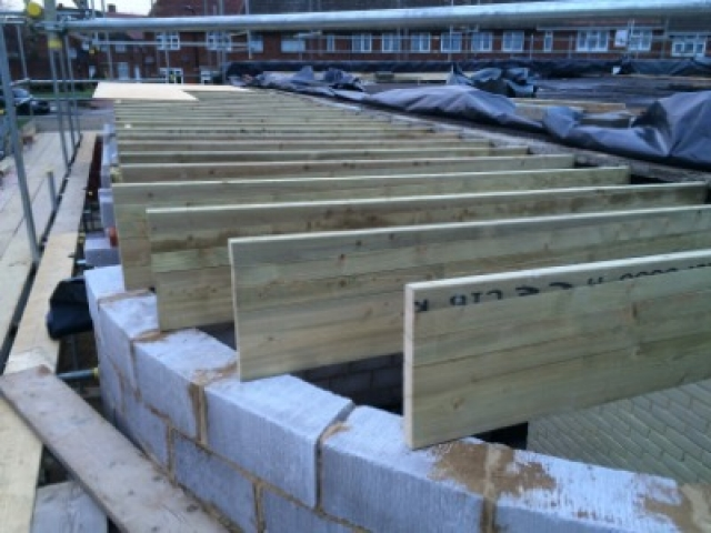 Timber joists being fitted in London building project