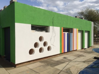 Building with double garage doors in London