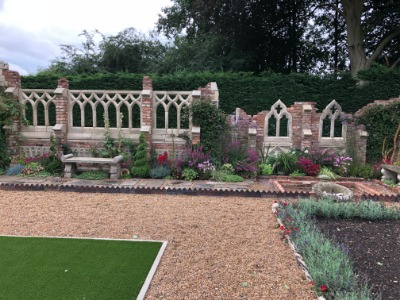 Garden features with stonework and stone bench
