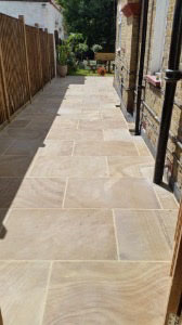 Paving side of house